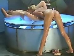 Beautiful chicks have fun on podium licking lesbian porn